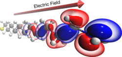Evaporation and Fragmentation of Organic Molecules in Strong Electric Fields Simulated with DFT